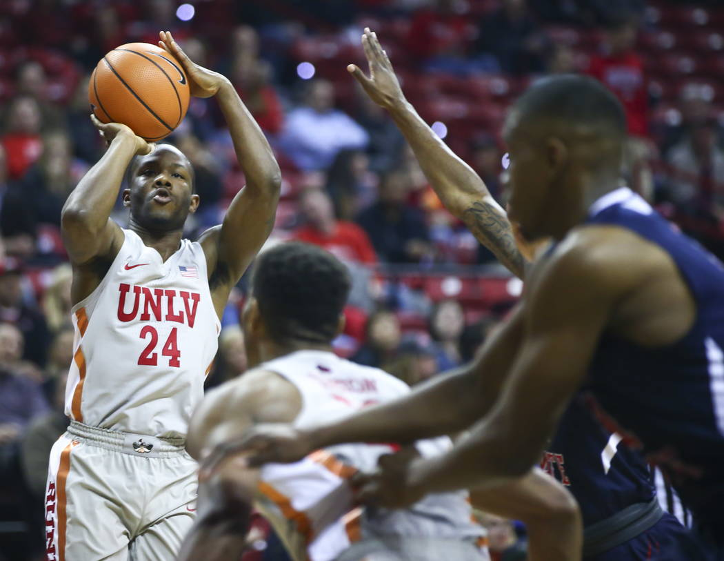 UNLV Rebels guard Jordan Johnson (24) goes up to shoot against the Fresno State Bulldogs during the first half of a basketball game at the Thomas & Mack Center in Las Vegas on Wednesday, Feb.  ...