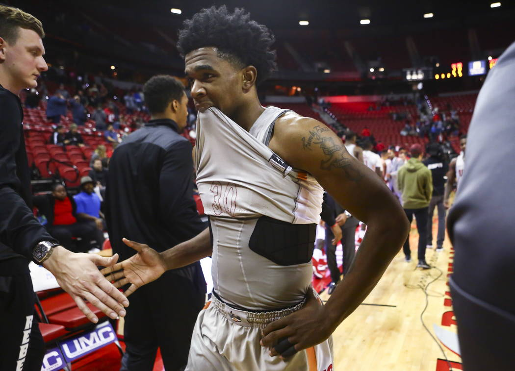 UNLV Rebels guard Jovan Mooring (30) reacts after losing to Fresno State in a basketball game at the Thomas & Mack Center in Las Vegas on Wednesday, Feb. 21, 2018. Chase Stevens Las Vegas Revi ...