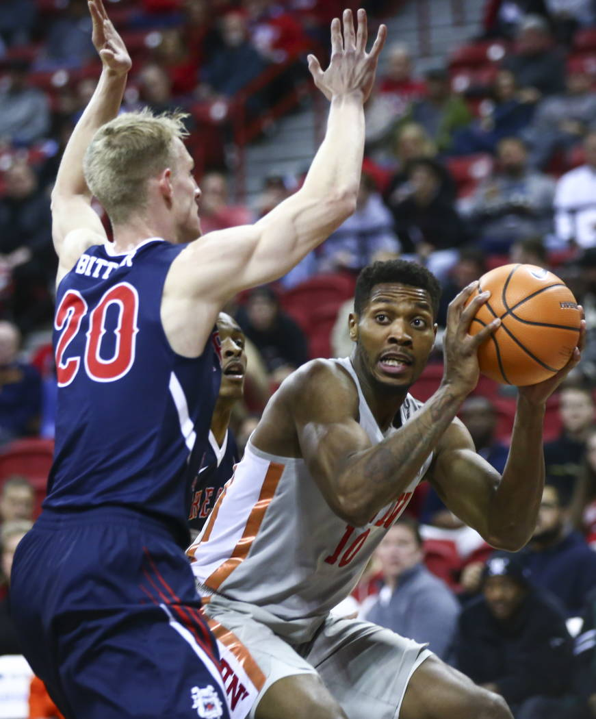 UNLV Rebels forward Shakur Juiston (10) looks to pass as Fresno State Bulldogs forward Sam Bittner (20) defends during the second half of a basketball game at the Thomas & Mack Center in Las V ...