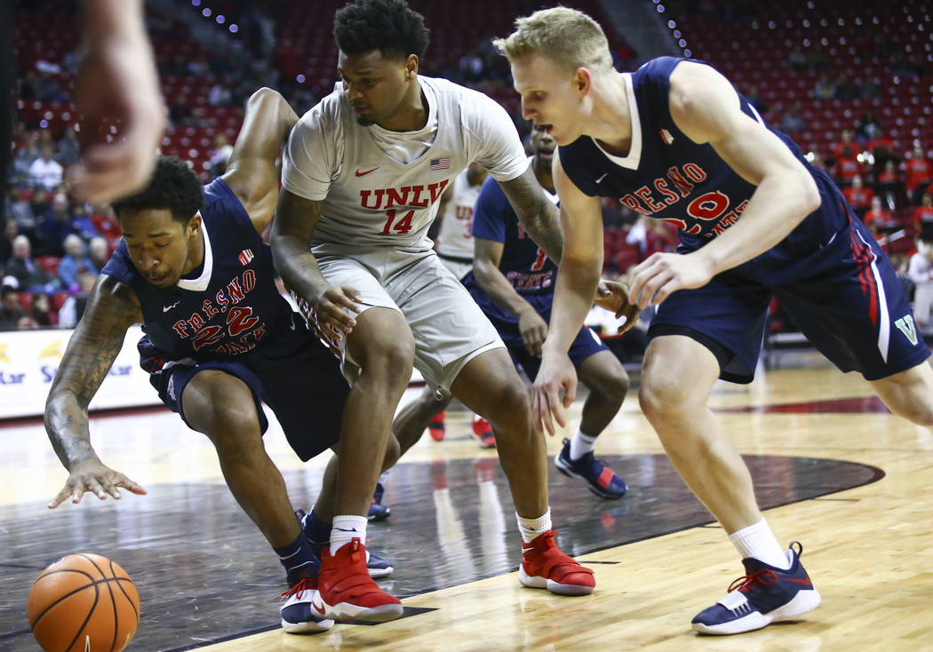 Fresno State Bulldogs guard Ray Bowles Jr. (22) goes for a loose ball over UNLV Rebels forward Tervell Beck (14) as Fresno State Bulldogs forward Sam Bittner (20) looks on during the first half of ...