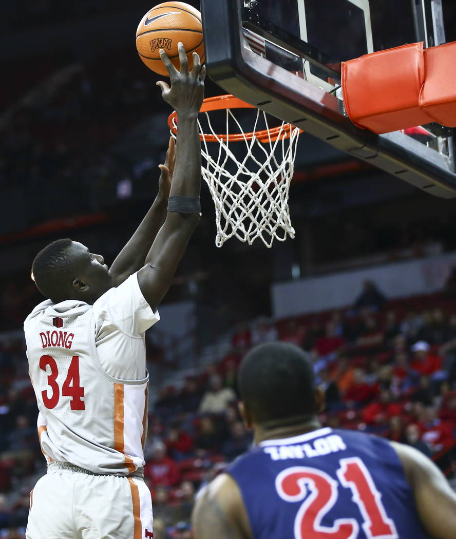 UNLV Rebels forward Cheikh Mbacke Diong (34) goes to the over Fresno State Bulldogs guard Deshon Taylor (21) during the second half of a basketball game at the Thomas & Mack Center in Las Vega ...