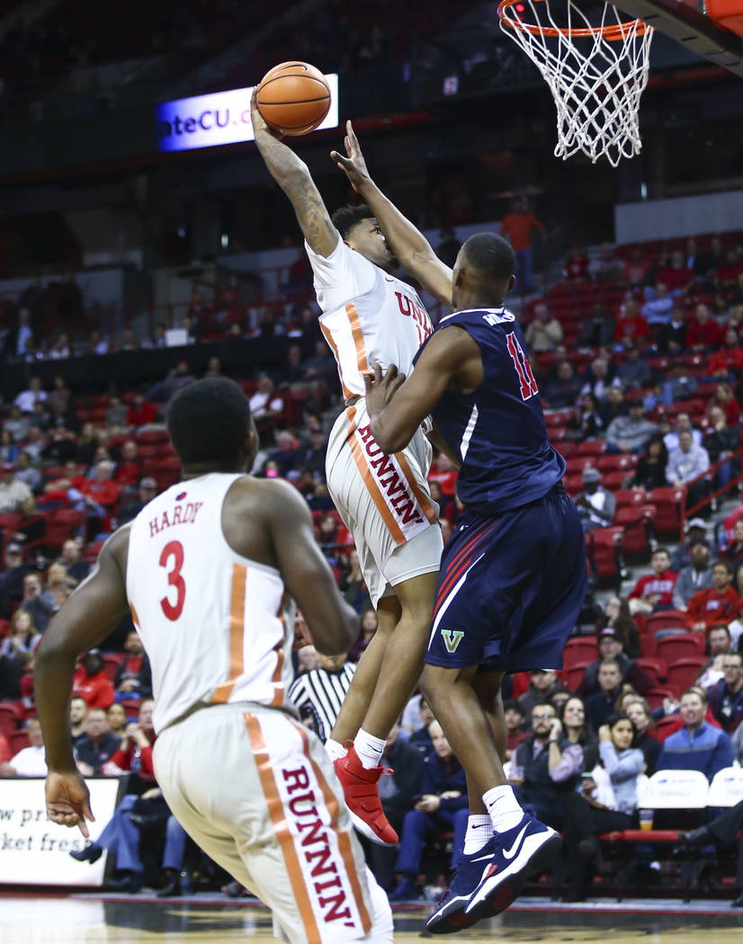 UNLV Rebels forward Tervell Beck (14) gets fouled by Fresno State Bulldogs forward Bryson Williams (11) during the second half of a basketball game at the Thomas & Mack Center in Las Vegas on  ...