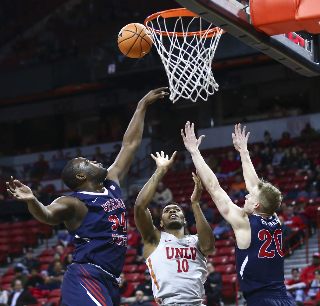 UNLV Rebels forward Shakur Juiston (10) goes up for a shot between Fresno State Bulldogs center Terrell Carter II (34) and forward Sam Bittner (20) during the second half of a basketball game at t ...