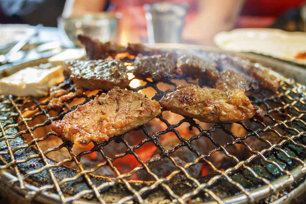 Juicy meat cooking in a Korean BBQ restuarant in Ulsan, South Korea. Thinkstock