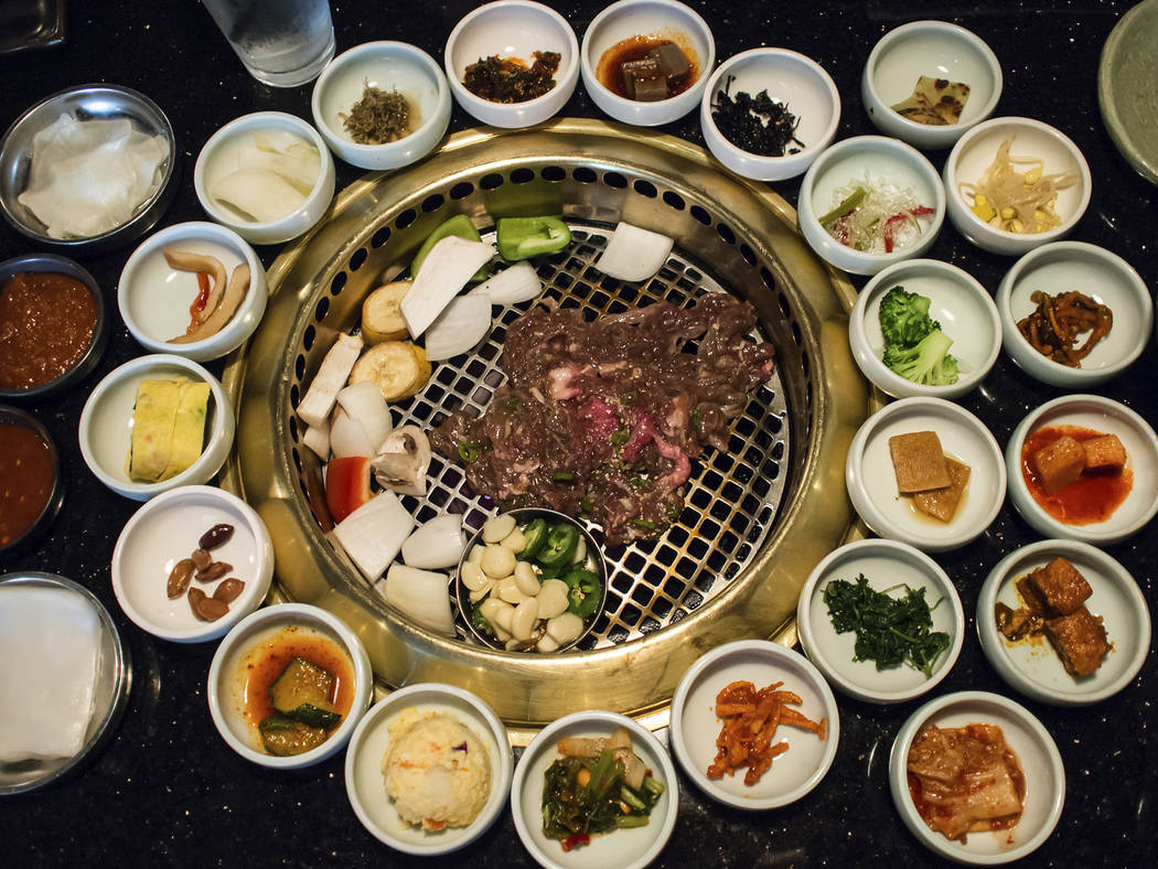 Korean BBQ with full side dishes. Thinkstock