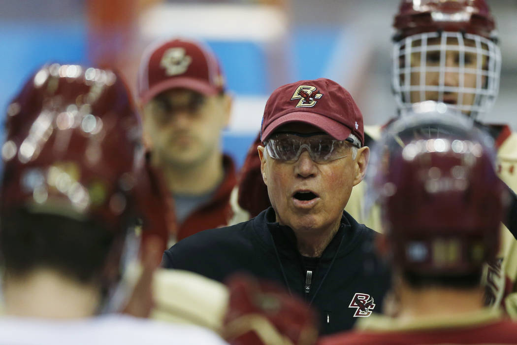 Boston College head coach Jerry York directs his team during team practice for the NCAA men's college hockey Frozen Four tournament Wednesday, April 9, 2014, in Philadelphia. (AP Photo/Matt Rourke)
