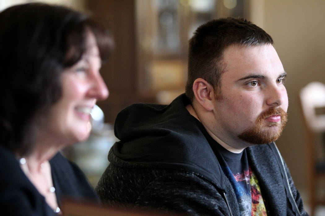Nick Touma, 22, and his mother Kathy Touma, 57, talk to a reporter in Kathy's Las Vegas home Wednesday, Feb. 7, 2018, about Nick receiving a retroactive diploma from the Clark County School Distri ...