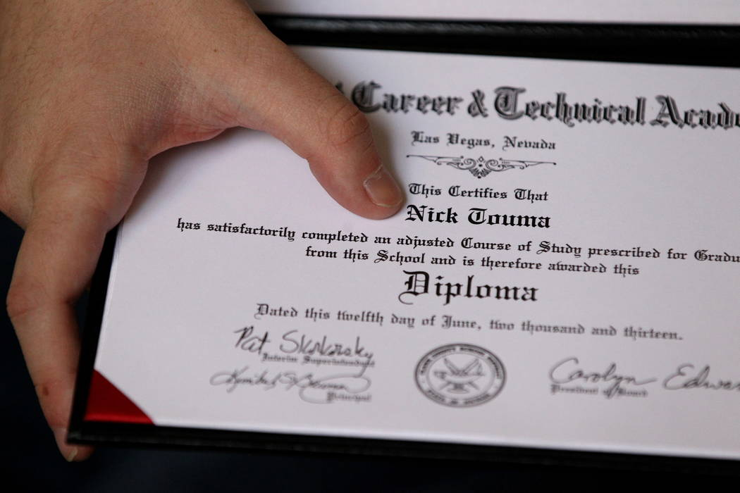 "Nick Touma, 22, points out the word ""adjusted"" on his 2013 Northwest Career and Technical Academy diploma during an interview at his mother's Las Vegas home Wednesday, Feb. 7, 20 ..."