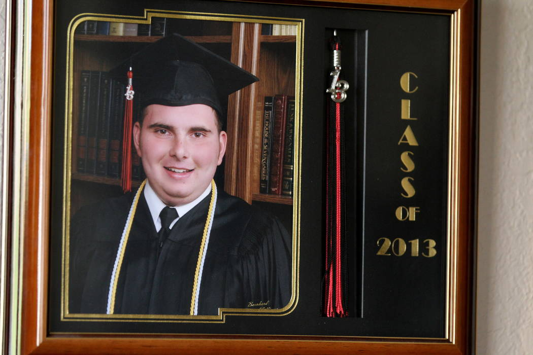 Nick Touma, now 22, shown in his 2013 Northwest Career and Technical Academy graduation photo at his mother's Las Vegas home Wednesday, Feb. 7, 2018. Nick and others will receive a retroactive dip ...