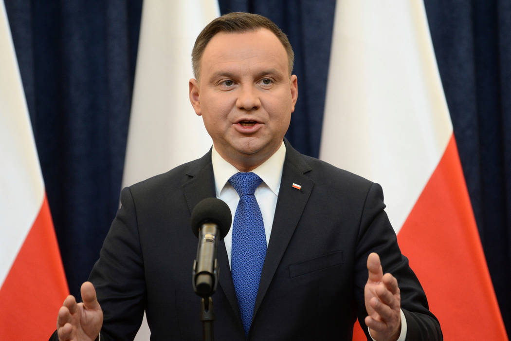 Polish President Andrzej Duda announces his decision to sign a legislation penalizing certain statements about the Holocaust, in Warsaw, Poland, Tuesday, Feb. 6, 2018. Duda said that he will also  ...