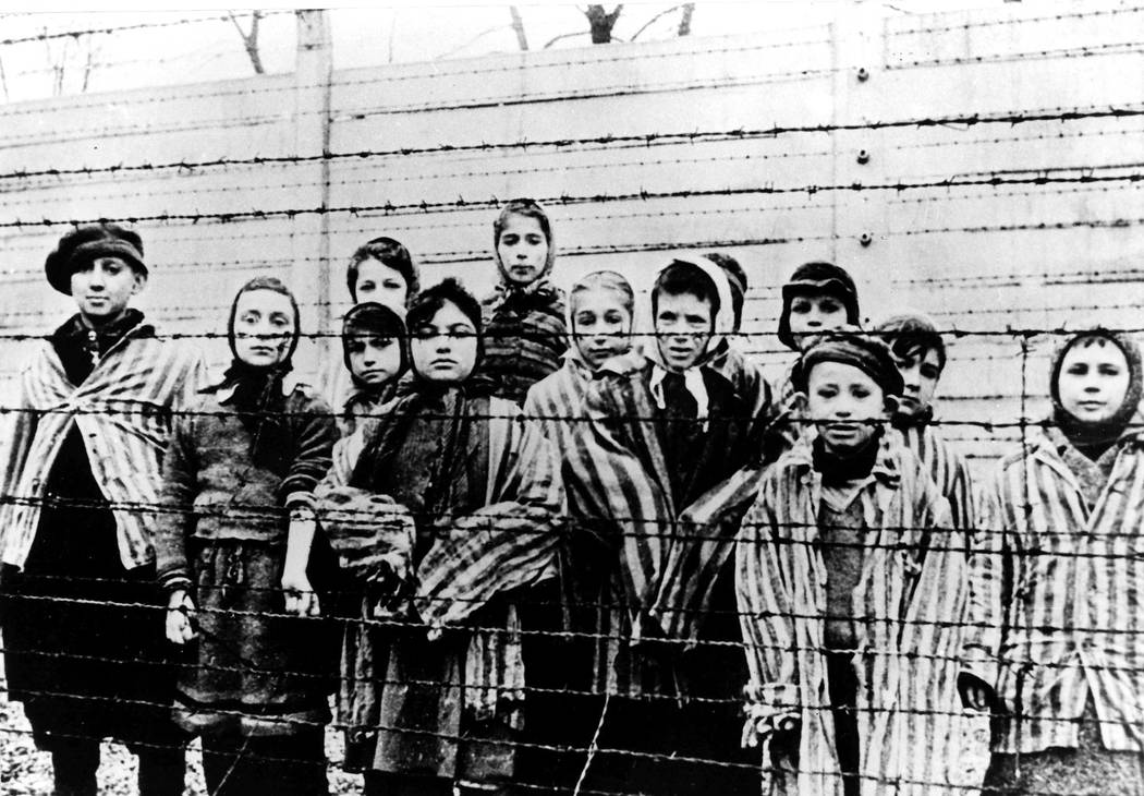 A picture taken just after the liberation by the Soviet army in January, 1945, shows a group of children wearing concentration camp uniforms including Martha Weiss who was ten years-old, 6th from  ...