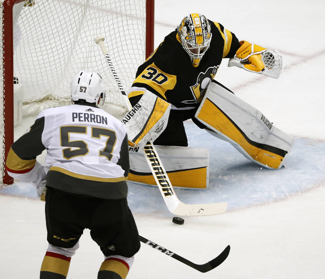 Pittsburgh Penguins goaltender Matt Murray (30) stops a shot by Vegas Golden Knights' David Perron (57) during the first period of an NHL hockey game in Pittsburgh, Tuesday, Feb. 6, 2018. (AP Phot ...