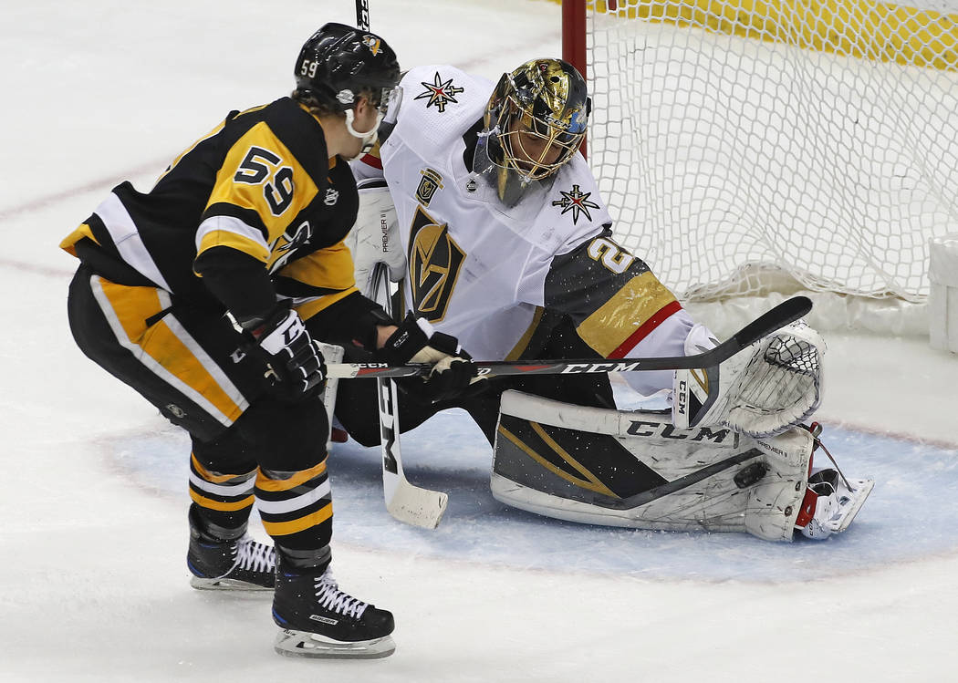 Vegas Golden Knights goaltender Marc-Andre Fleury (29) stop a shot by Pittsburgh Penguins' Jake Guentzel (59) during the first period of an NHL hockey game in Pittsburgh, Tuesday, Feb. 6, 2018. (A ...