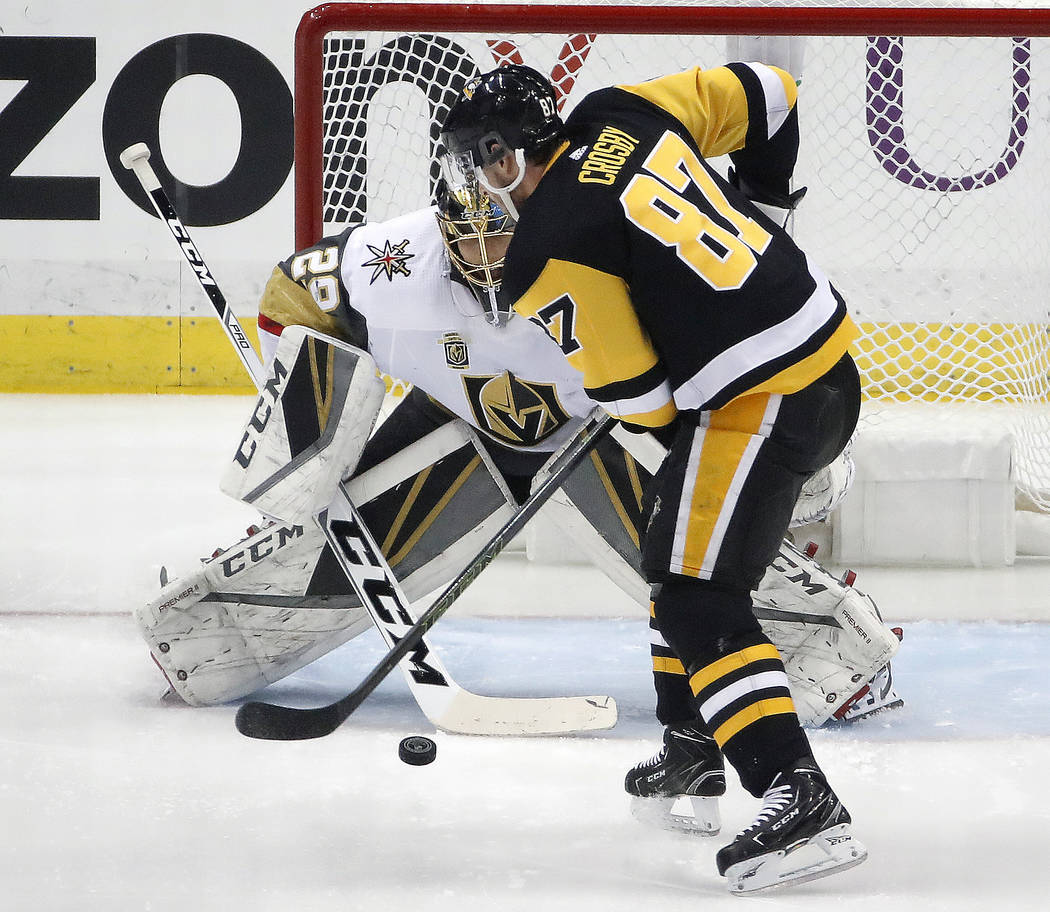 Pittsburgh Penguins' Sidney Crosby (87) can't get a shot past Vegas Golden Knights goaltender Marc-Andre Fleury (29) win the first period of an NHL hockey game in Pittsburgh, Tuesday, Feb. 6, 2018 ...