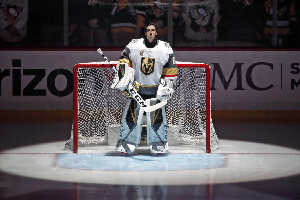 Vegas Golden Knights goaltender Marc-Andre Fleury (29) stands during the National Anthem before an NHL hockey game against his former team, the Pittsburgh Penguins, in Pittsburgh, Tuesday, Feb. 6, ...