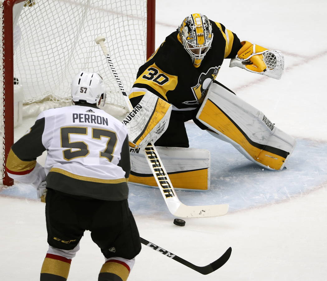Pittsburgh Penguins goaltender Matt Murray (30) stops a shot by Vegas Golden Knights' David Perron (57) in the first period of an NHL hockey game in Pittsburgh, Tuesday, Feb. 6, 2018. (AP Photo/Ge ...