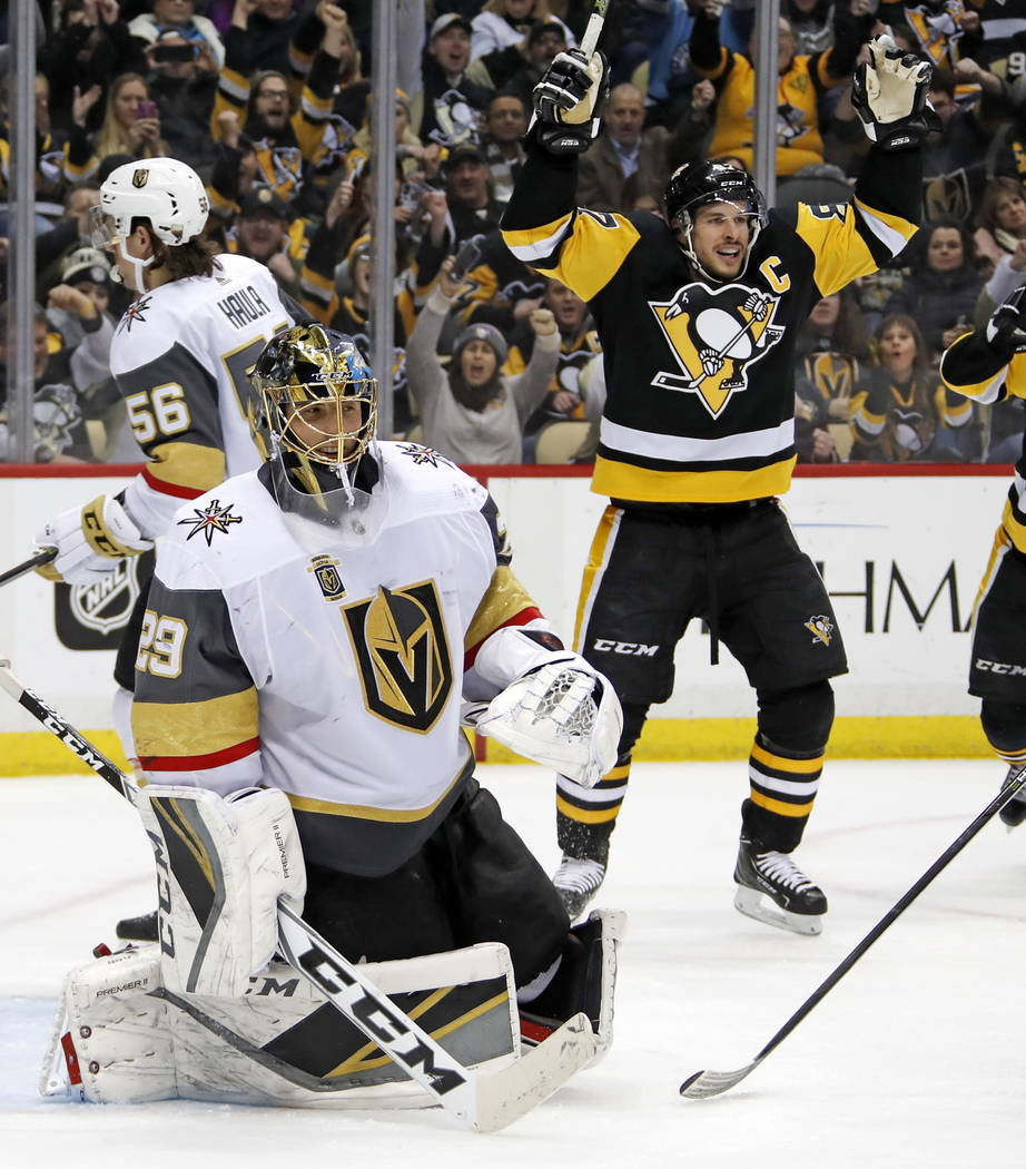 Pittsburgh Penguins' Sidney Crosby (87) celebrates assisting on a goal by Ian Cole as Vegas Golden Knights goaltender Marc-Andre Fleury (29) collects himself during the second period of an NHL hoc ...