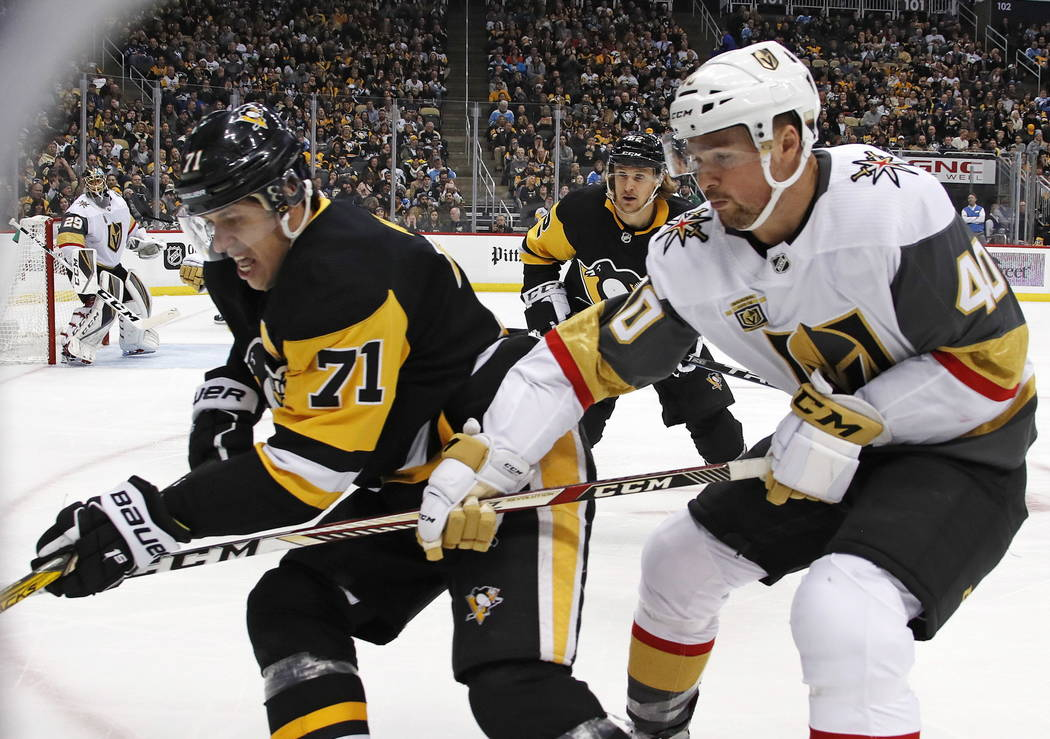 Pittsburgh Penguins' Evgeni Malkin (71) goes after a puck in the corner with Vegas Golden Knights' Ryan Carpenter (40) defending during the second period of an NHL hockey game in Pittsburgh, Tuesd ...