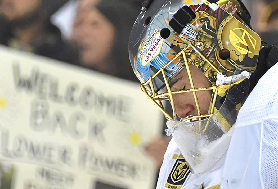 Las Vegas Golden Knights goalie Marc-Andre Fleury holds back tears during a welcome-back tribute video Tuesday, Feb. 6, 2018, in Pittsburgh, where he returned for his first game against the Pittsb ...