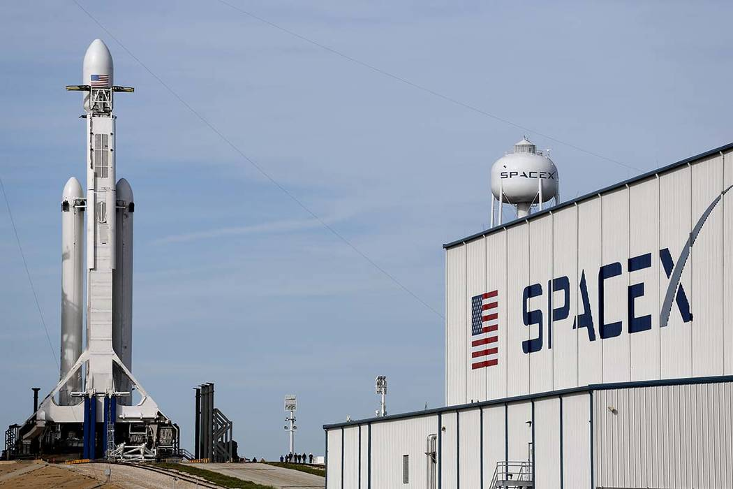 The Falcon 9 SpaceX heavy rocket stands ready for launch on pad 39A at the Kennedy Space Center in Cape Canaveral, Florida, Monday, Feb. 5, 2018. The Falcon Heavy scheduled to launch Tuesday after ...