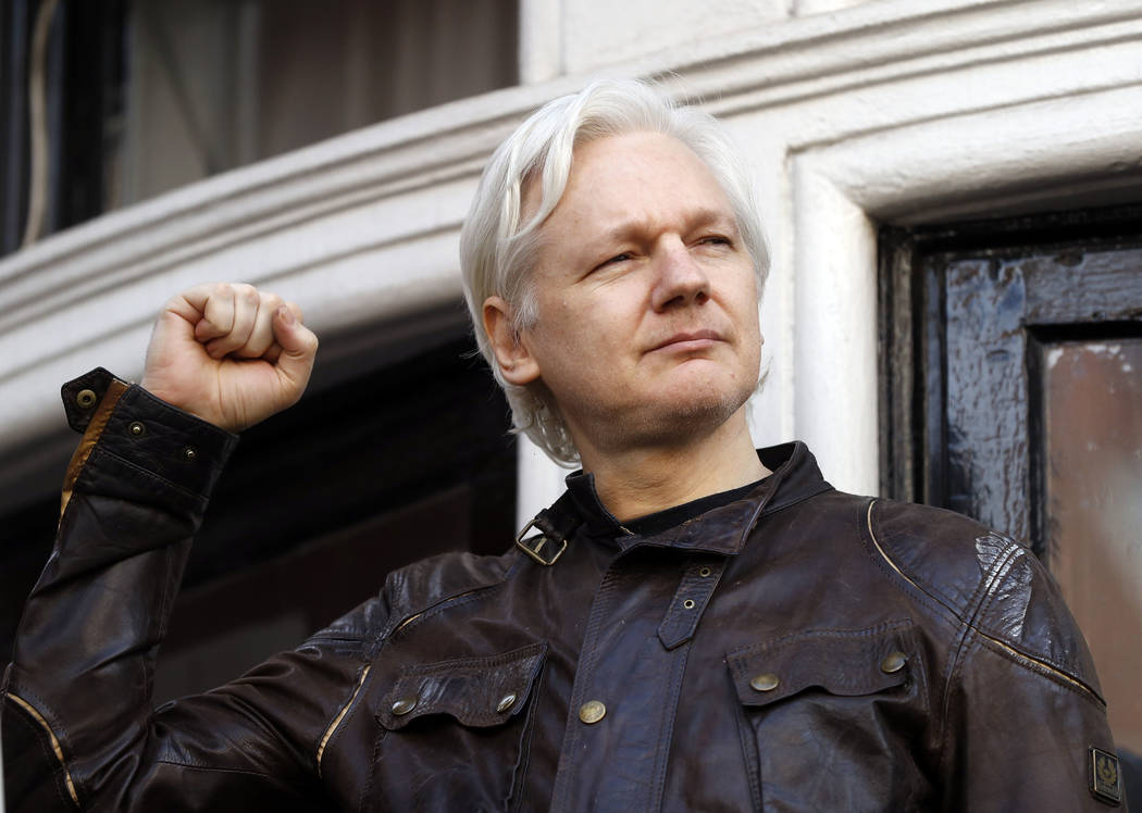 WikiLeaks founder Julian Assange greets supporters outside the Ecuadorian embassy in London, where he has been in self imposed exile since 2012, May 19, 2017. On Tuesday Feb. 6, 2018, a British ju ...