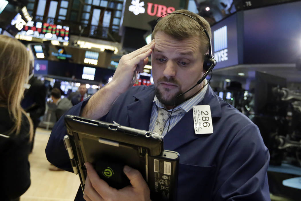 Trader Michael Milano works on the floor of the New York Stock Exchange, Tuesday, Feb. 6, 2018. The Dow Jones industrial average fell as much as 500 points in early trading, bringing the index dow ...