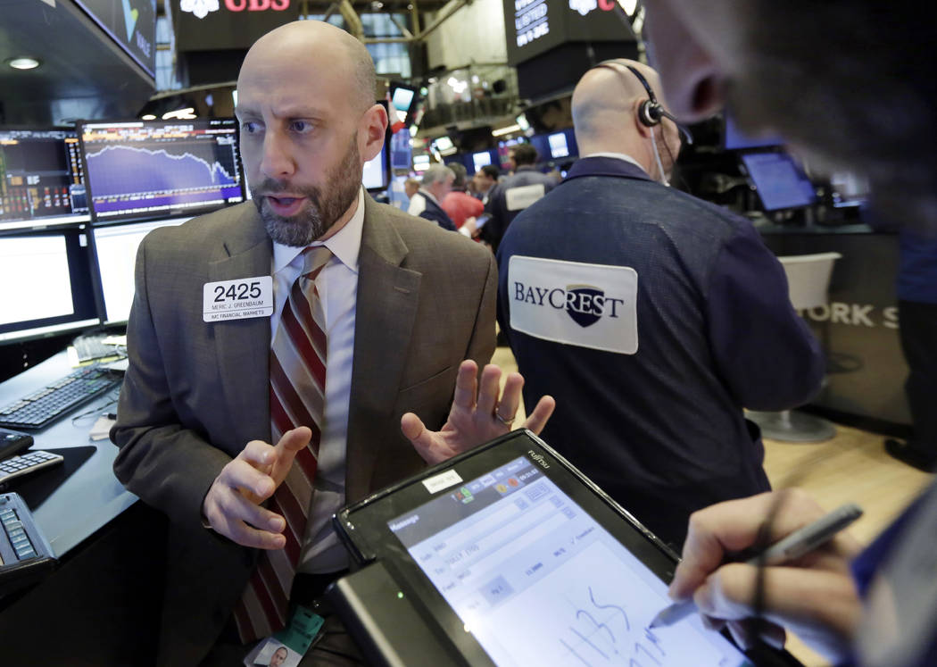 Specialist Meric Greenbaum works at his post on the floor of the New York Stock Exchange, Tuesday, Feb. 6, 2018. The Dow Jones industrial average fell as much as 500 points in early trading, bring ...