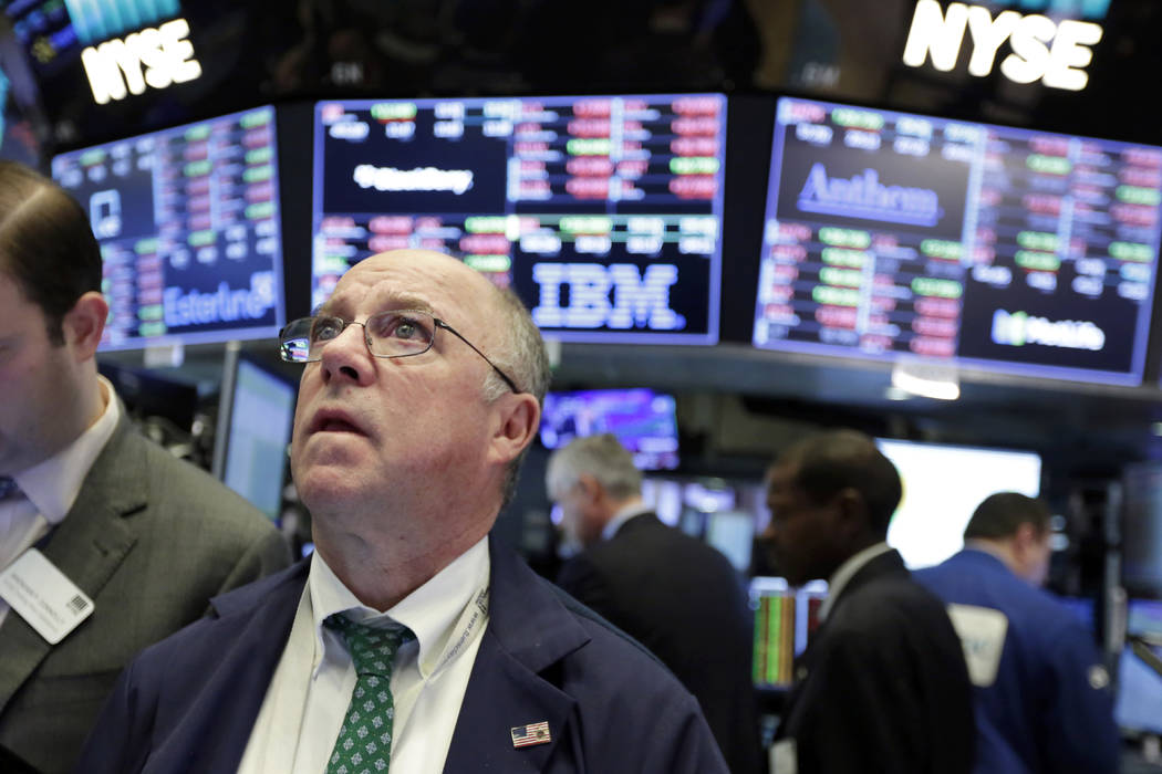 Trader Frederick Reimer works on the floor of the New York Stock Exchange, Tuesday, Feb. 6, 2018. The Dow Jones industrial average fell as much as 500 points in early trading, bringing the index d ...