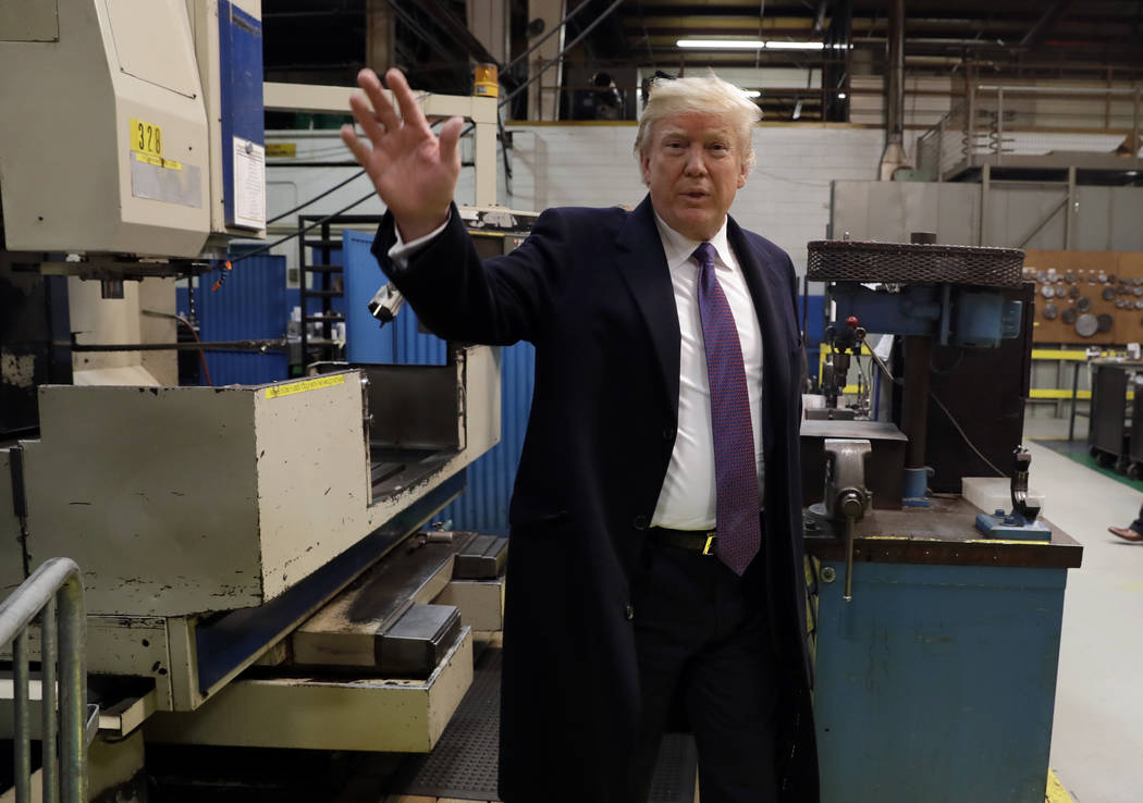 President Donald Trump waves as he participates in a tour of Sheffer Corporation to promote his tax policy, Monday, Feb. 5, 2018, in Cincinnati. (Evan Vucci/AP)