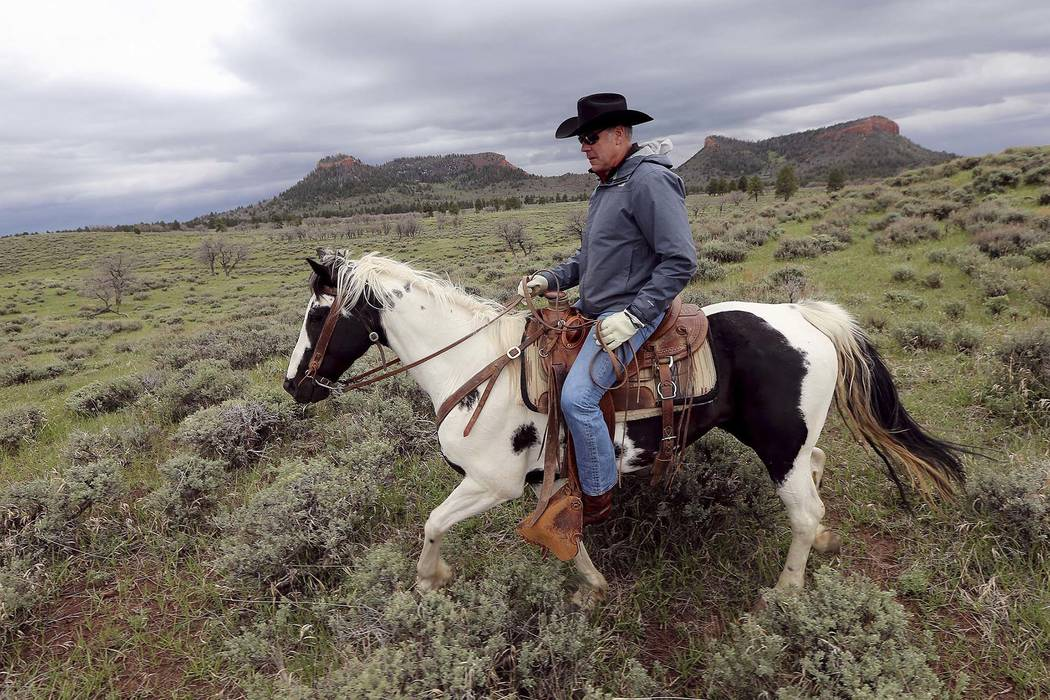 Interior Secretary Ryan Zinke rides a horse in the new Bears Ears National Monument near Blanding, Utah, May 9, 2017. Much of Bears Ears is on land administered by the Bureau of Land Management, w ...