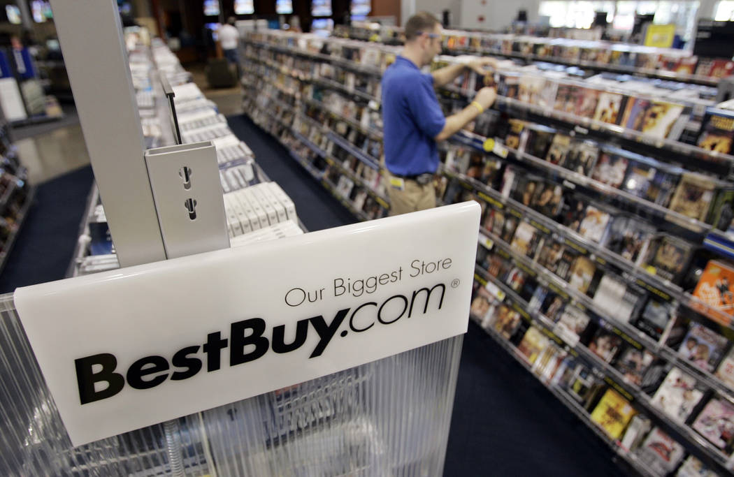 A Best Buy sign is posted next to a display of movie DVDs and music CDs at a Best Buy store in Mountain View, Calif., Tuesday, June 19, 2007. Best Buy Co., the nation's largest consumer electronic ...