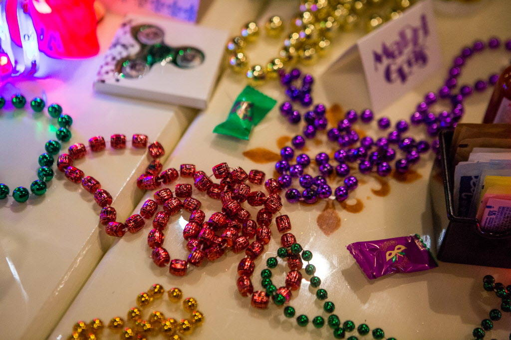 Mardi Gras beads on a table for the Krewe of Okeanos celebration at Lola's in Summerlin on Saturday, Feb. 3, 2018.  Patrick Connolly Las Vegas Review-Journal @PConnPie
