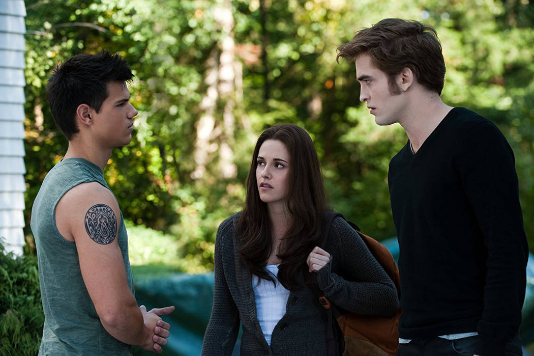 """From left, Taylor Lautner, Kristen Stewart and Robert Pattinson appear in a scene from """"The Twilight Saga: Eclipse."""" (Kimberley French/Summit Entertainment)"""