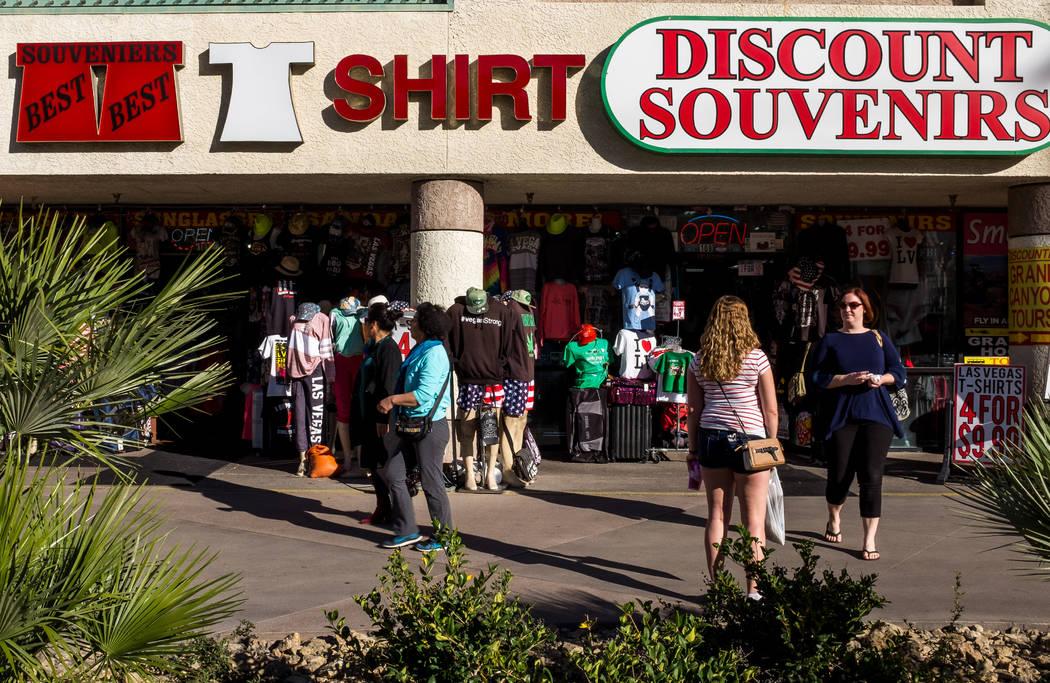 Strip visitors walk past a Discount Souvenirs shop on Las Vegas Boulevard on Wednesday, Feb. 7, 2018.  Patrick Connolly Las Vegas Review-Journal @PConnPie