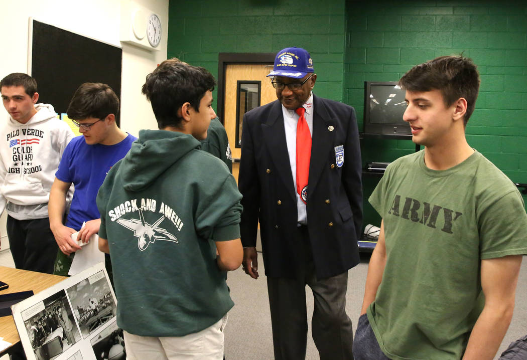 Robert Lee Porter, center, a retired Air Force veteran and past president of the the San Diego chapter of the Tuskegee Airmen, speaks with Ismael Alqazzaz, left, and Zac D'Amato, at Palo Verde Hig ...