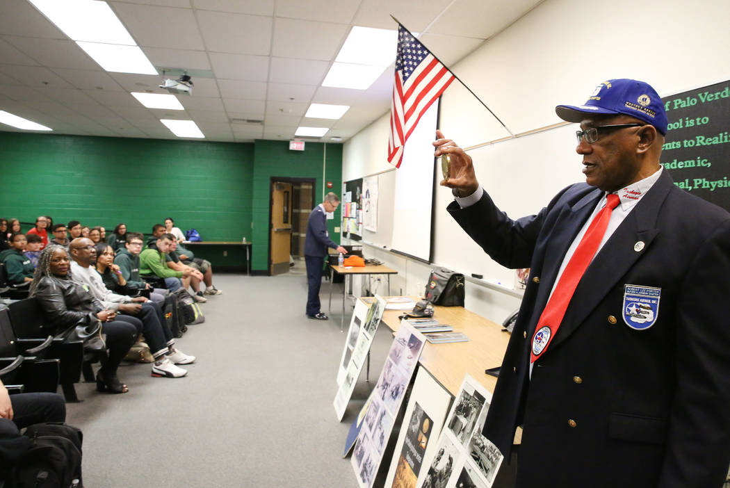 Robert Lee Porter, a retired Air Force veteran and past president of the the San Diego chapter of the Tuskegee Airmen, shows a replica of the Congressional Gold Medal, given to him by Airmen, as h ...