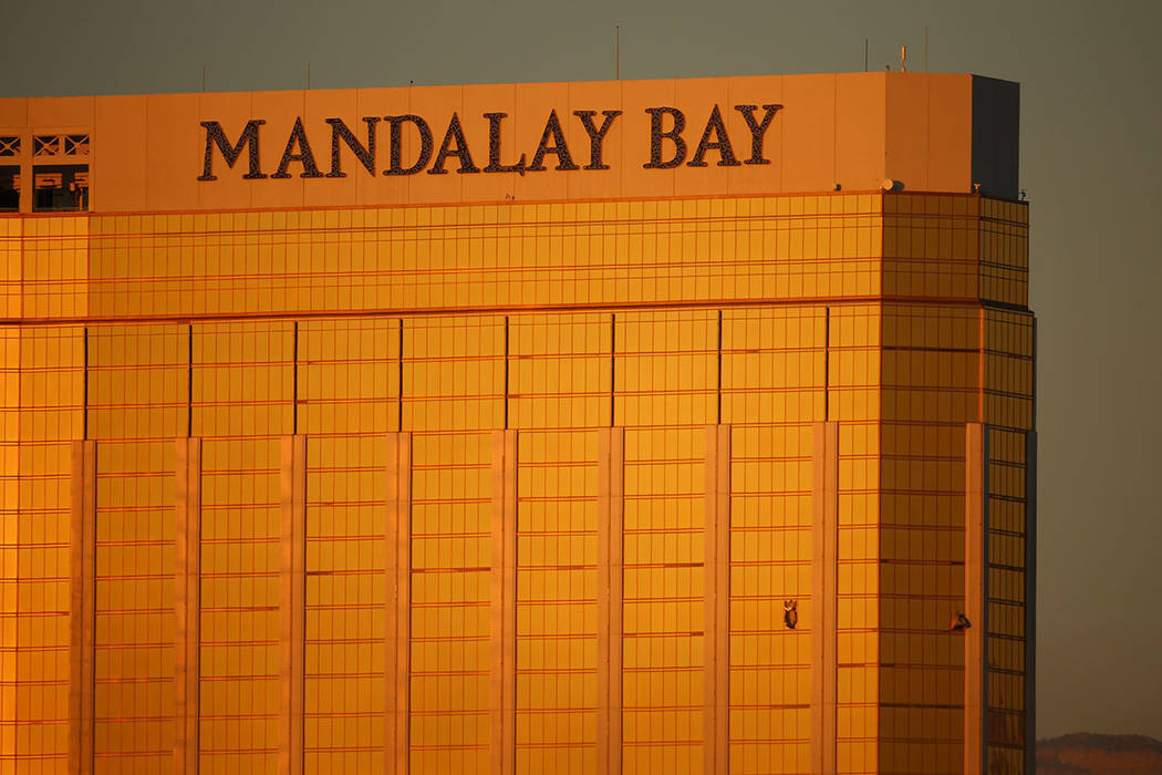 Two windows are blown out from Mandalay Bay the morning after a mass shooting left 58 dead and over 500 injured in Las Vegas, Monday, Oct. 2, 2017. (Joel Angel Juarez/Las Vegas Review-Journal)