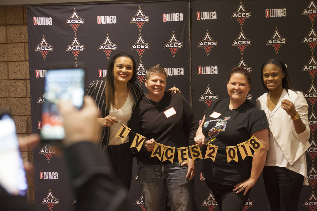 Las Vegas Aces guard Kayla McBride, from left, fan Nichole Coleman, fan Jaymine Netterfield and Aces point guard Moriah Jefferson pose for a photo at the Mandalay Bay Event Center in Las Vegas, Tu ...