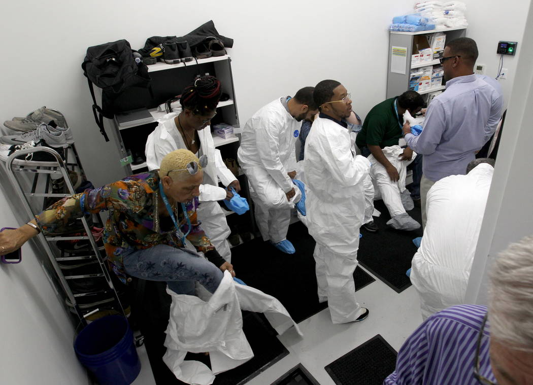 New Jersey lawmakers and cannabis Industry officials prepare to tour GreenMart of Nevada NLV LLC in North Las Vegas Friday, Feb. 9, 2018, as part of a three-day marijuana ' fact-finding trip' to s ...