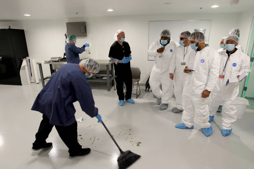 Jason Gully, chief operating officer of GreenMart of Nevada NLV LLC in North Las Vegas, third from left, gives a tour of his facility to New Jersey lawmakers and cannabis industry officials on a t ...