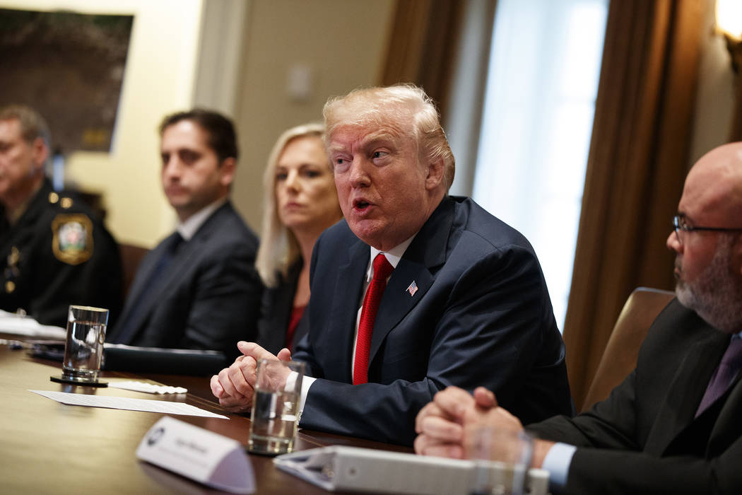 President Donald Trump speaks during a meeting with law enforcement officials on the MS-13 street gang and border security, in the Cabinet Room of the White House, Tuesday, Feb. 6, 2018, in Washin ...