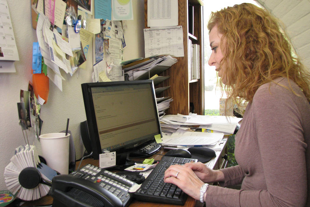 Daniele Dreitzer, executive director of The Rape Crisis Center works in her office at 801 S. Rancho Blvd. in 2014. (Las Vegas Review-Journal)