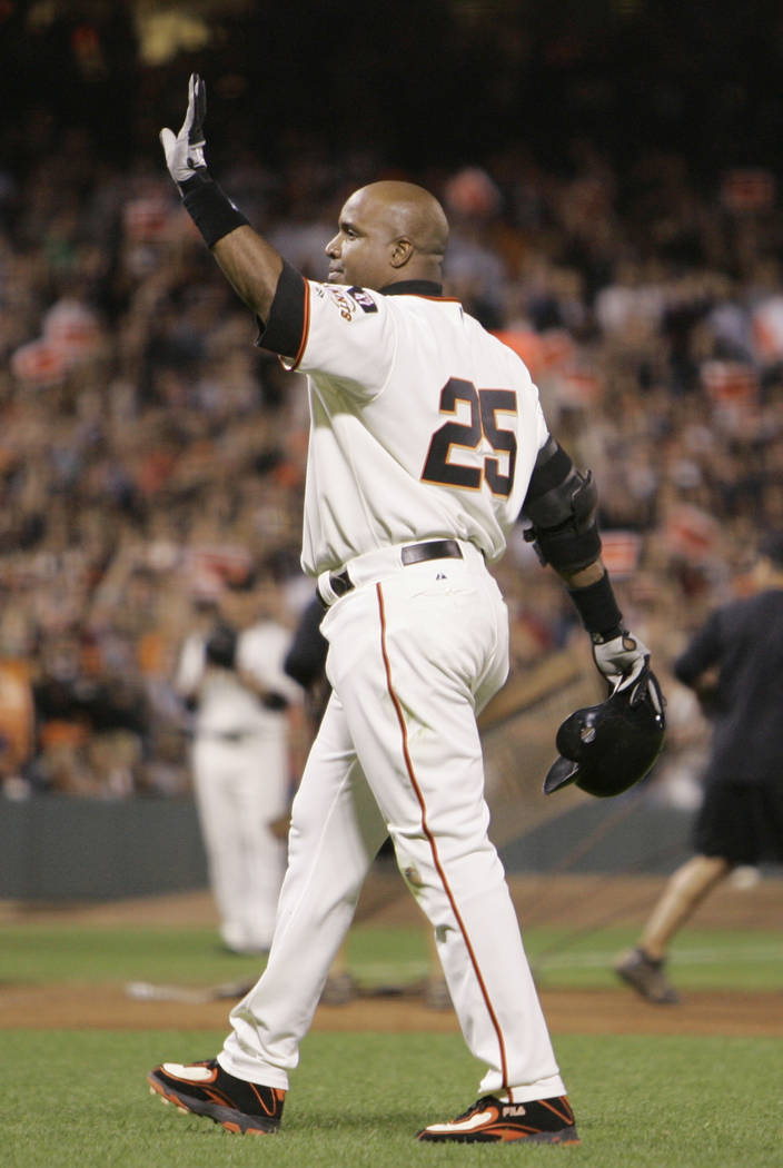In this Sept. 26, 2007, file photo, San Francisco Giants' Barry Bonds waves goodbye to the fans at AT&T Park after his final at bat against the San Diego Padres in the sixth inning of their ba ...