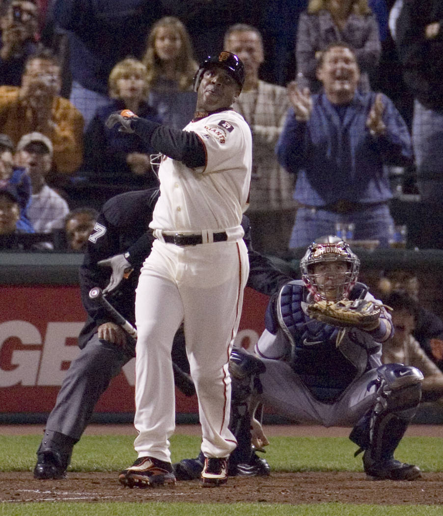 In this Aug. 7, 2007, file photo,  San Francisco Giants' Barry Bonds drops his bat after hitting his 756th career home run during the fifth inning of a baseball game off Washington Nationals' Mike ...