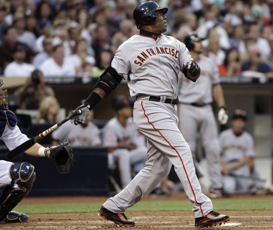 In this Aug. 4, 2007, file photo, San Francisco Giants' Barry Bonds watches a home run, the 755th of his career, during the second inning of the team's baseball game against the San Diego Padres i ...