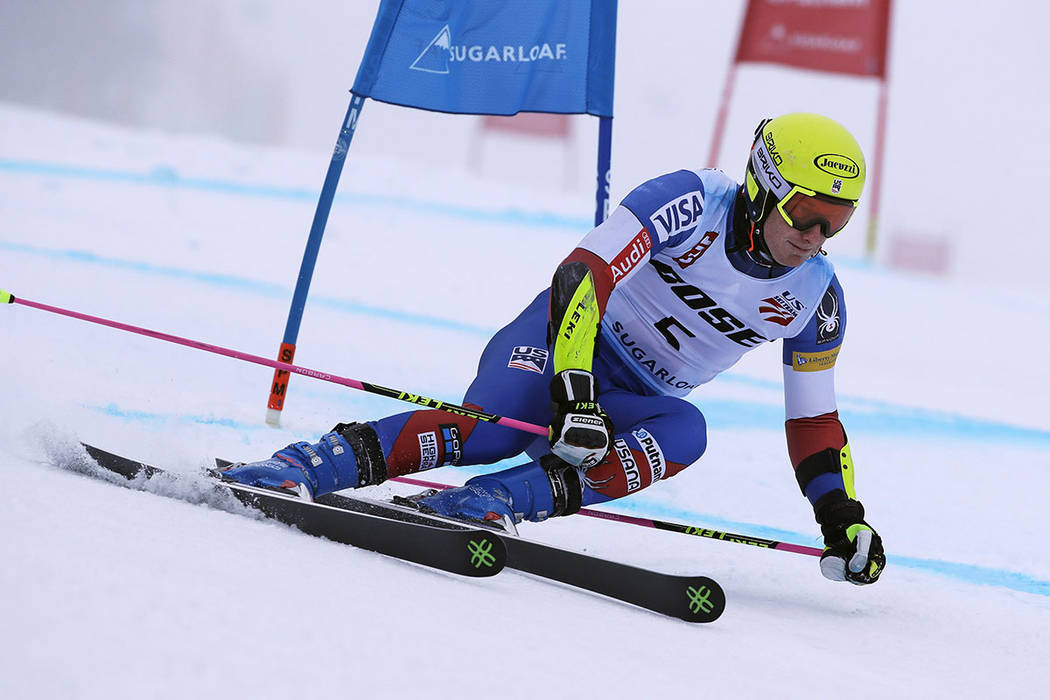 Tim Jitloff, of Reno, Nev., carves a turn during the first run of the men's giant slalom skiing race at the U.S. Alpine Ski Championships at Sugarloaf Mountain Resort in Carrabassett Valley, Maine ...
