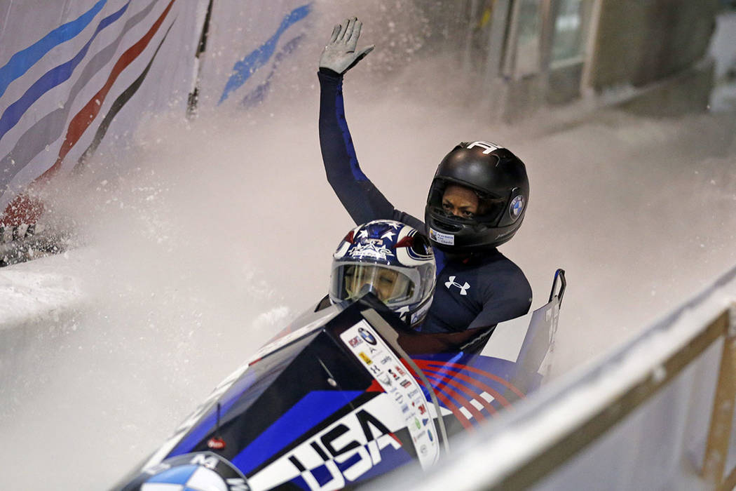 Driver Jamie Greubel Poser, left, and Lauren Gibbs celebrate after winning the women's bobsled World Cup race Friday, Nov. 17, 2017, in Park City, Utah. (AP Photo/Rick Bowmer)
