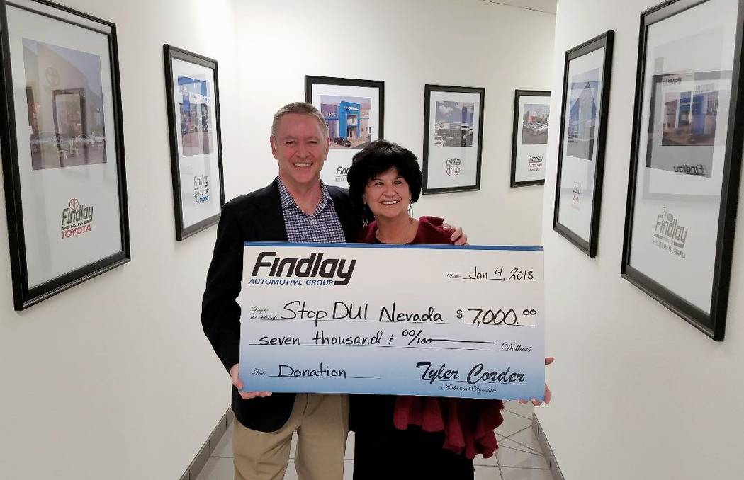 Findlay Automotive Findlay Automotive Group CFO Tyler Corder presents a donation of $7,000 to Sandy Heverly, the executive director and co-founder of Stop DUI.