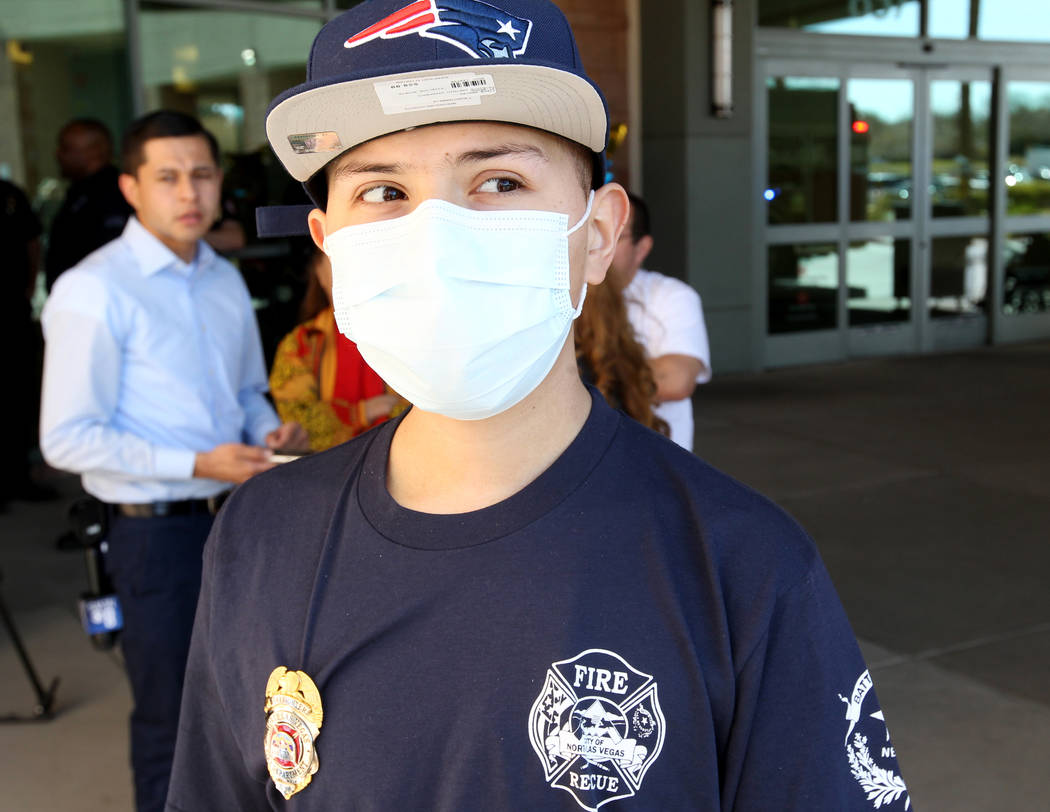 Leukemia patient Johnathan Rubio, 16, talks to the news media after being released from Summerlin Hospital Medical Center on Tuesday, Feb. 6, 2018. Rubio, who is a member of the department's Explo ...