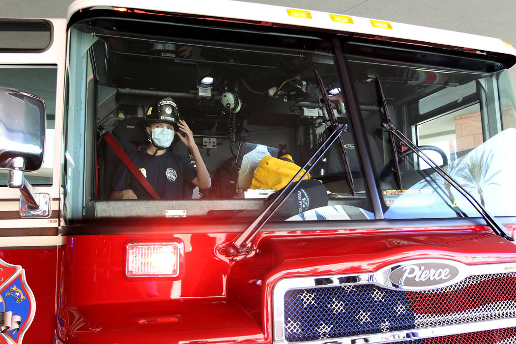 Leukemia patient Johnathan Rubio, 16, prepares for a ride home on a North Las Vegas Fire Department engine after being released from Summerlin Hospital Medical Center on Tuesday, Feb. 6, 2018. Rub ...